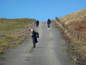 walkers walking up kilpatrick hills