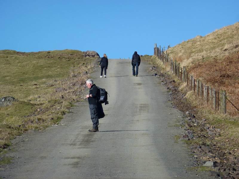 walkers walking up kilpatrick hills