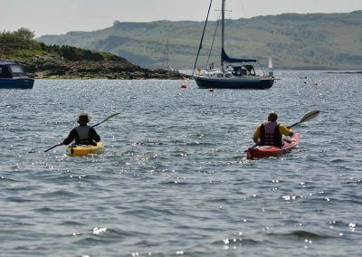 Canoeists in Newton Bay, Millport