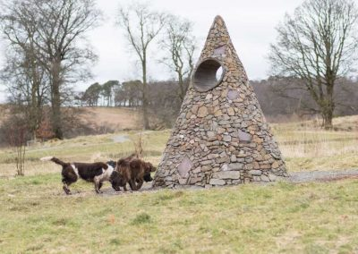 The dogs examine a monument